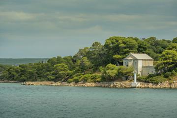 light house on small island in mediteranian sea in Croatia