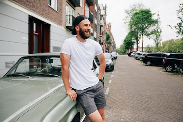 Hipster  model with beard  wearing white blank  t-shirt with space for your logo or design in casual urban style