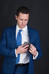 man checking up mobile phone