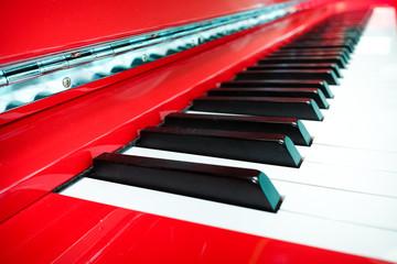 piano keys on red piano