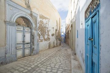 street with old wooden doors in Tunisia
