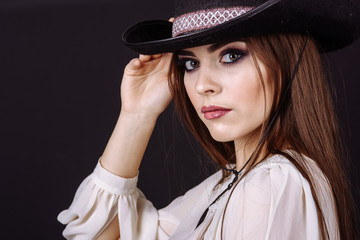 Portrait of a beautiful woman in cowboy's hat