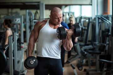 Bodybuilder deals with dumbbells