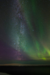 Beautiful and breathtaking view of Aurora Borealis (northern lights) and Milky way on the winter night sky in Vatnsnes peninsula, east Iceland