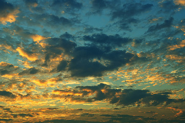 Sunset makes the sky and cloud  a beautiful golden yellow.