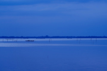 Blue sky hour after sunset. Dusk sea and clouds scape.