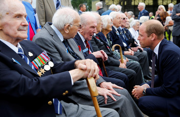 Britain's Prince William, Patron of the Battle of Britain Memorial Flight, speaks with veteran George 'Johnny' Johnson at RAF Coningsby to mark the Flight's 60th Anniversary in Britain