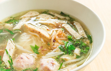 Vietnamese soup Pho Bo with vegetables and rice noodles in a bowl