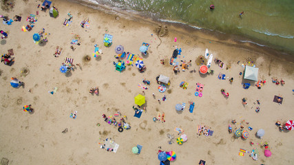 People enjoy the sandy beach at Sauble Beach, Ontario, Canada