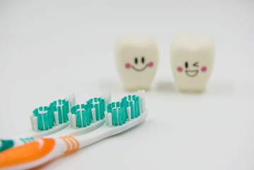 New toothbrush and Model Cute toys teeth in dentistry on a white background.