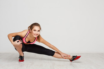 Fitness woman at stretching training indoors