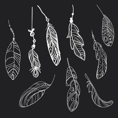Vector set of stylized bird feathers. Collection of feathers for decoration. Black and white drawing by hand. Linear Art. Tattoo.