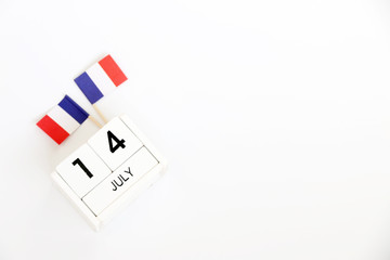 14 july Wooden calendar and Happy Bastille Day. Concept National Day France,independence day of France,Copy space,minimal style