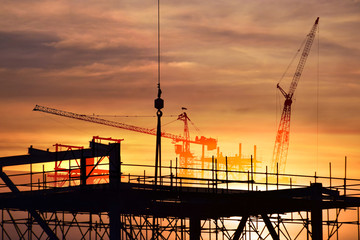 Silhouette construction site background .