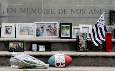 Pictures and messages are seen on a memorial in memory of the victims of the July 14 fatal truck attack on the Promenade des Anglais in Nice