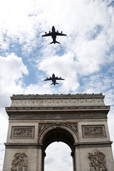 Airbus A400M military aircrafts fly over the Arc de Triomphe during a rehearsal of the traditional Bastille Day military parade in Paris