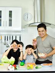 Happy family in kitchen