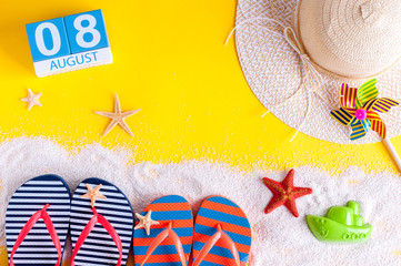 August 8th. Image of august 8 calendar with summer beach accessories and traveler outfit on background. Summer day, Vacation concept