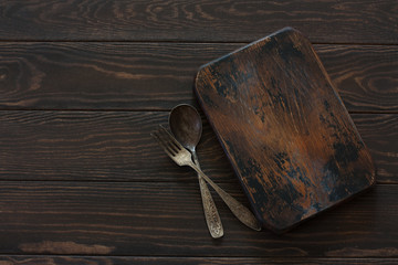 Empty old cutting board over old wood background