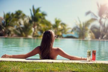 woman enjoying sun at paradise