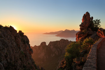 Fotomurales - Cliffs of the famous Calanches and the Golf of Porto at the island of Corsica, France, during sunset.
