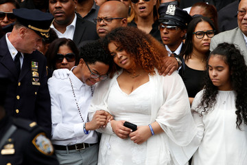 Family members of slain New York City Police Department (NYPD) officer Miosotis Familia react outside the World Changers Church following her funeral service in the Bronx borough of New York City