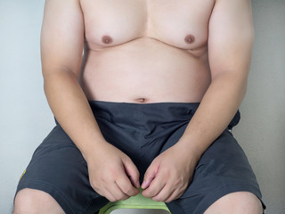Body part of asian fat man with a big belly
