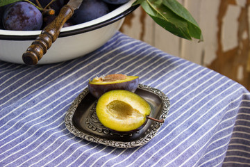 Ripe plums on tablecloths
