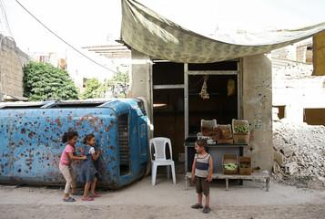 Children play in the rebel held besieged Douma neighbourhood of Damascus