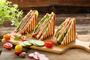 Fresh sandwiches on wooden background