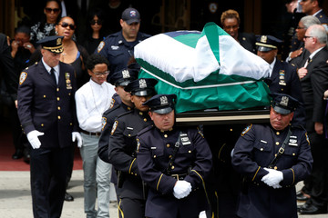 The coffin containing slain New York City Police Department (NYPD) officer Miosotis Familia is carried from the World Changers Church following her funeral service in the Bronx borough of New York City