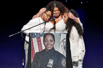 Genesis Villella and twins Delilah and Peter Vega children of NYPD officer Miosotis Familia during her funeral service in New York City