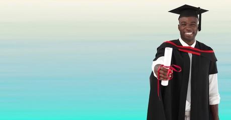 Graduate man smiling against blurry blue background