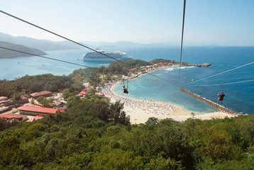 People doing zip line in caribbean coast