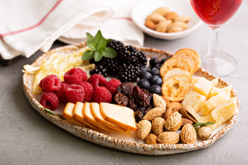 Cheese plate with nuts and berries