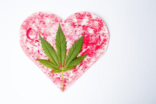 Marijuana leaf on a red heart shape