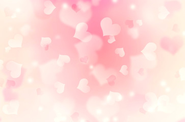 Heart shaped bokeh pink blurred background.