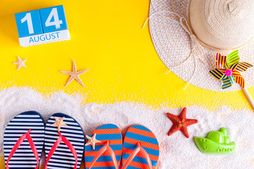 August 14th. Image of august 14 calendar with summer beach accessories and traveler outfit on background. Summer day, Vacation concept