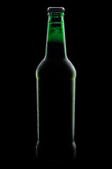 green bottle of beer, clipping path,on a black background, with brilliant edges and foam