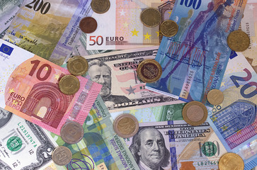 Abstract dollar euro swiss franc and coins background.