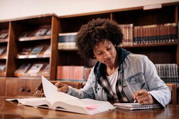 University student taking notes