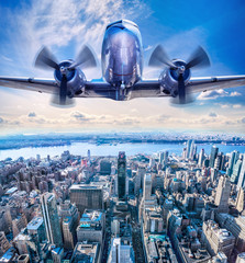 Wall Mural - vintage airplane in the sky over manhattan