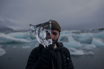 Man with a piece of Ice