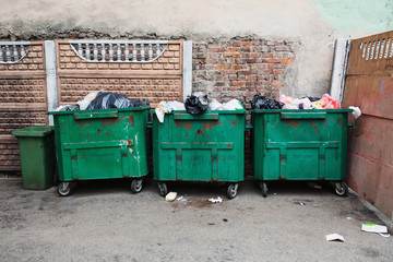 Green containers with garbage.