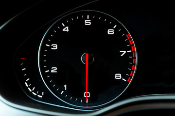Luxury car's dasboard part - tachometer.