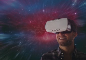 Man in VR headset smiling against galaxy background