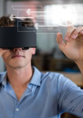 Man in VR headset touching interface