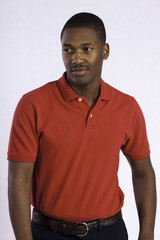 Thoughtful black man in red shirt looking left