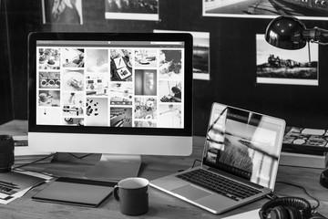 Photos on a desktop computer on the desk