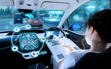 young woman reading a magazine in a autonomous car. driverless car. self-driving vehicle. heads up display. right hand drive.
